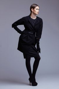 high fashion portrait of elegant woman in black coat. Studio sho