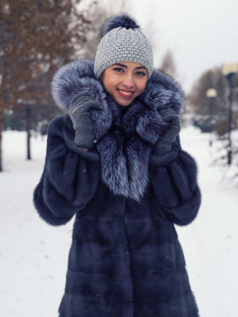 Beautiful Russian girl in a chic winter coat