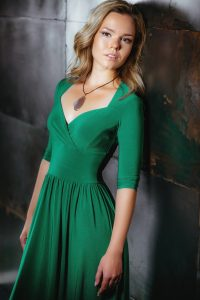 Beautiful girl model in a green dress