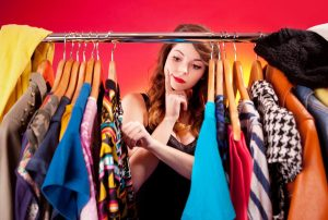 Nothing to wear concept, young woman deciding what to put on